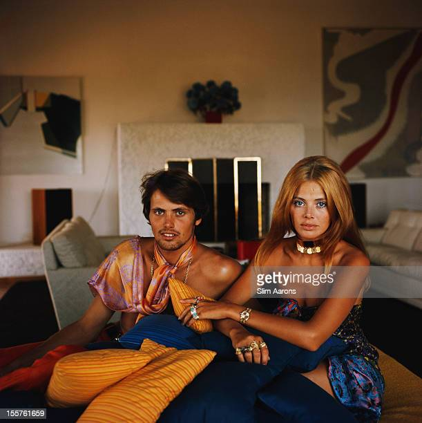 Britt Ekland, Swedish actress, and her brother, sitting with a pile of small cushions in Porto Ercole, Italy, circa 1975.