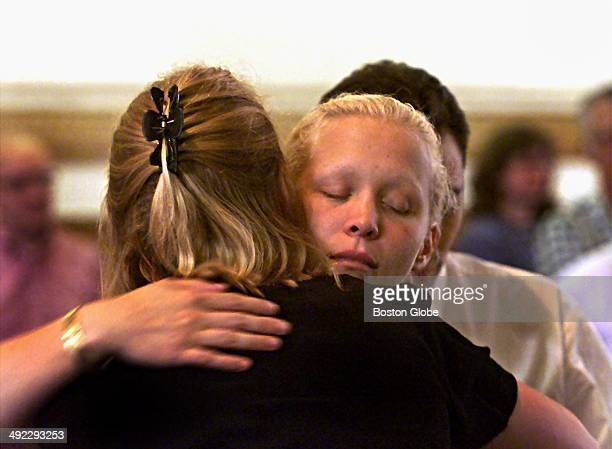 Britt Greineder hugs her sister Kirsten Greineder back to camera during a break in the trial of their father Dr Dirk Greineder at Norfolk Superior...