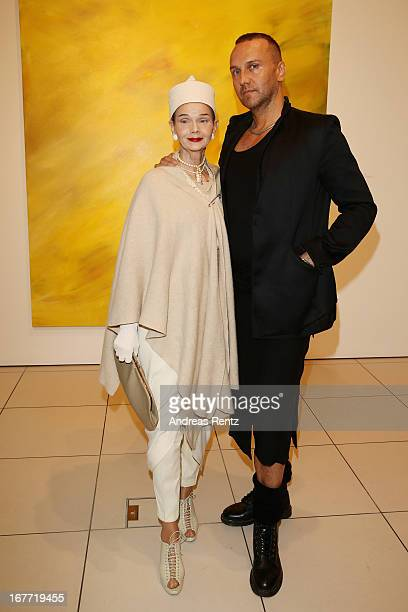 Britt Kanja and Hubertus Regout attend the Laurel Holloman 'All The World Inside' exhibition opening at Palazzo Italia on April 27 2013 in Berlin...