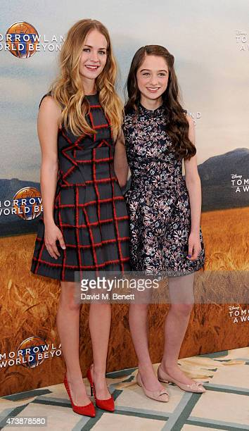 Britt Robertson and Raffey Cassidy pose at a photocall for Tomorrowland at Claridge's Hotel on May 18 2015 in London England