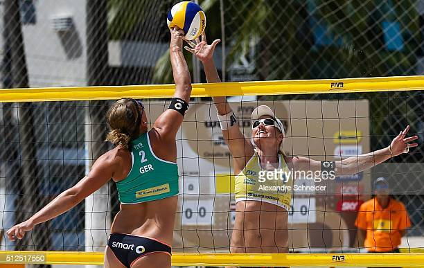 Britta Buthe of Germany spikes the ball against Barbara Hansel of Austria during the main draw match at Pajucara beach during day four of the FIVB...