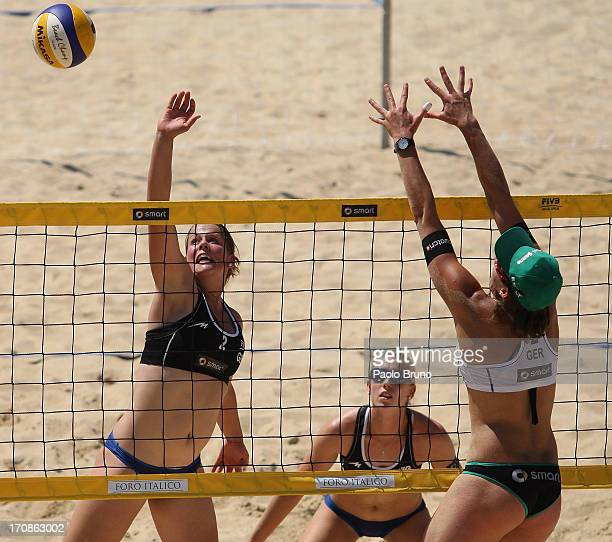 Britta Buthe of Germany spikes the ball as Kira Walkenhorst of Germany of blocks during the women's main draw of FIVB Smart Grand Slam at Foro...