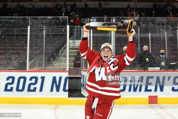 Britta Curl of the Wisconsin Badgers hoists the NCAA Championship Trophy following the Badgers 2-1 win over the Northeastern Huskies in overtime...