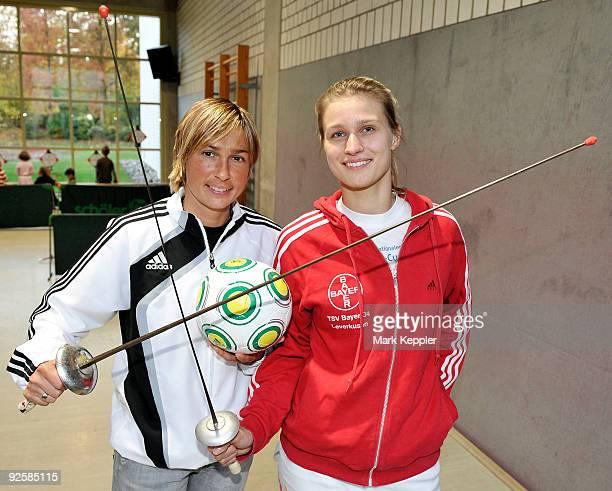 Britta Heidemann and Sandra Minnert pose during a fencing cup at Kurt-Riess sports ground on Oktober 31, 2009 in Leverkusen, Germany.