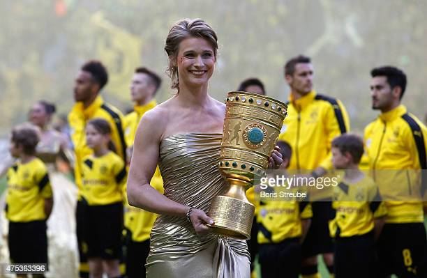 Britta Heidemann athlete and Olympic champion in fencing carries the trophy prior to the DFB Cup Final match between Borussia Dortmund and VfL...