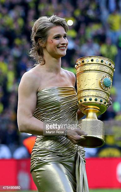 Britta Heidemann caries the trophy before DFB Cup Final match between Borussia Dortmund and VfL Wolfsburg at Olympiastadion on May 30 2015 in Berlin...
