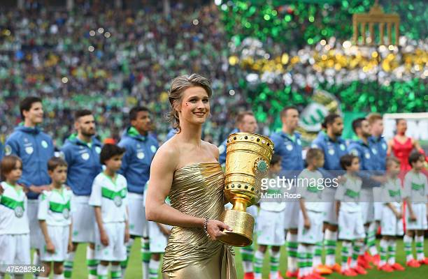 Britta Heidemann caries the trophy prior to the DFB Cup Final match between Borussia Dortmund and VfL Wolfsburg at Olympiastadion on May 30 2015 in...
