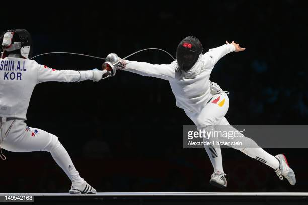 Britta Heidemann of Germany battles against A Lam Shin of Korea in the Women's Epee Individual Fencing Semifinals on Day 3 of the London 2012 Olympic...