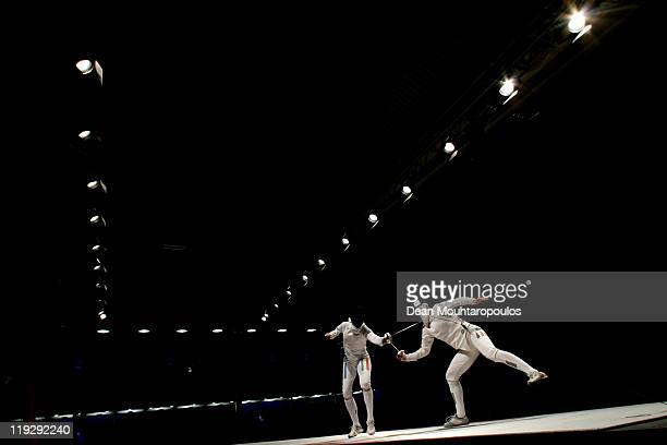 Britta Heidemann of Germany battles against Ana Branza of Romania in the Womens Senior Epee Semi Final during the 2011 European Fencing Championships...