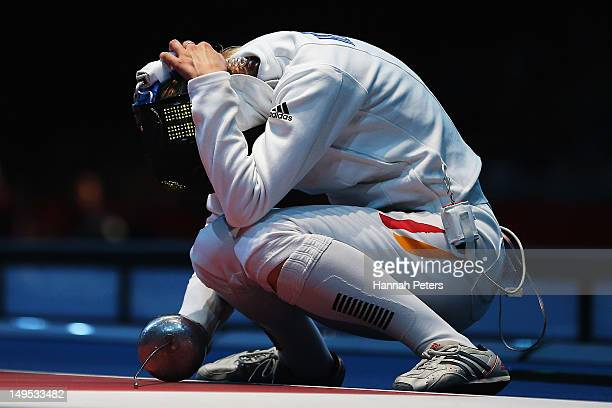 Britta Heidemann of Germany celebrates after defeating Sarra Besbes of Tunisia in the quarterfinals of the Women's Epee Individual Fencing on Day 3...
