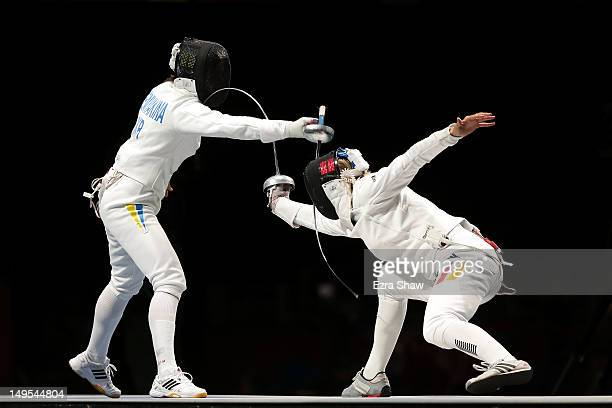 Britta Heidemann of Germany competes against Yana Shemyakina of Ukraine during the Gold medal bout in the Women's Epee Individual Fencing Finals on...