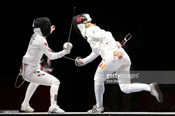 Britta Heidemann of Germany scores the final point against A Lam Shin of Korea in the Women's Epee Individual Fencing Semifinals on Day 3 of the...