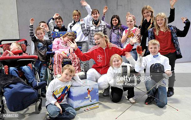 Britta Heidemann poses together with a group of children supporters during a fencing cup at Kurt-Riess sports ground on October 31, 2009 in...