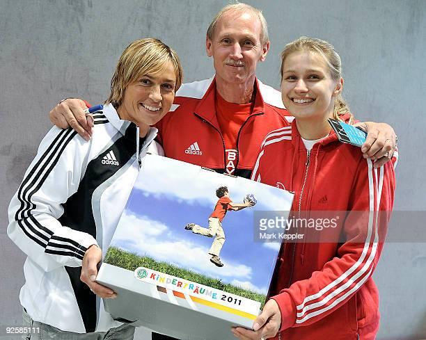 Britta Heidemann , Reinhard Heidemann and Sandra Minnert pose during a fencing cup at Kurt-Riess sports ground on October 31, 2009 in Leverkusen,...