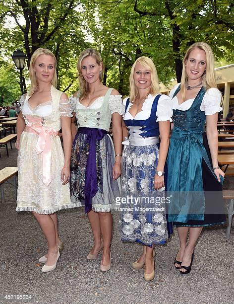 Britta Hofmann Marlen Neuenschwander Sandra Baumgartner and Ruth Hofmann attend the Sixt ladies dirndl dinner on July 15 2014 in Munich Germany