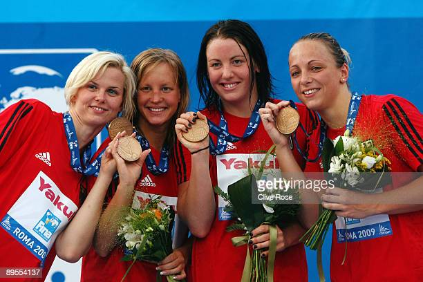 Britta Steffen Annika Mehlhorn Sarah Poewe and Daniela Samulski of Germany receive the bronze medal during the medal ceremony for the Women's 4x 100m...