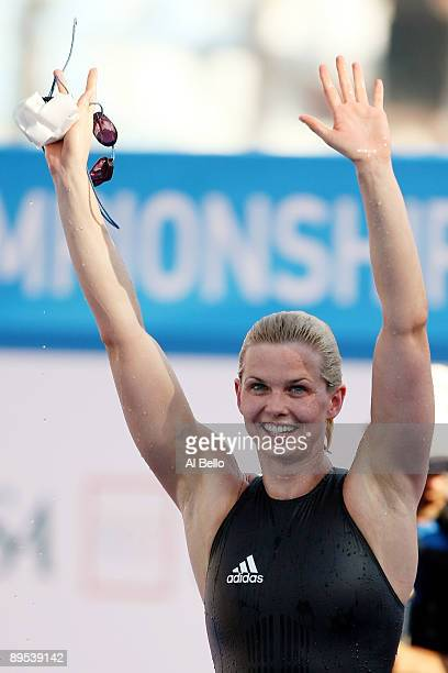 Britta Steffen of Germany celebrates after breaking the world record setting a new time of 5207 seconds in the Women's 100m Freestyle Final during...
