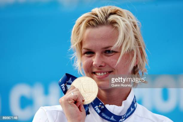 Britta Steffen of Germany receives the gold medal during the medal ceremony for the Women's 50m Freestyle Final during the 13th FINA World...