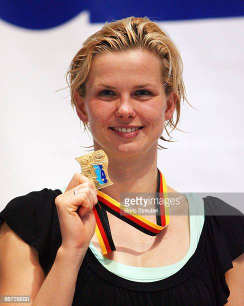 Britta Steffen of SG Neukoelln Berlin presents her medal for the german title after winning the women's 50 m freestyle A final during the German...