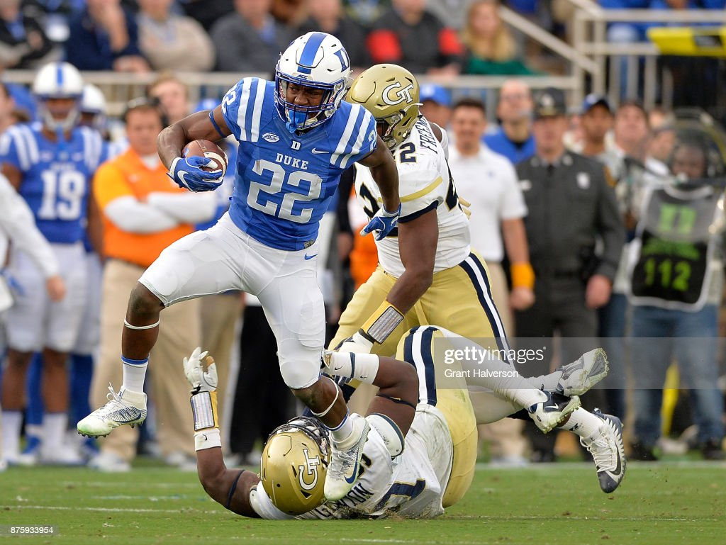 Brittain Brown #22 of the Duke Blue Devils breaks away from Brentavious Glanton #97 of the Georgia Tech Yellow Jackets for a long gain during their game at Wallace Wade Stadium on November 18, 2017 in Durham, North Carolina.