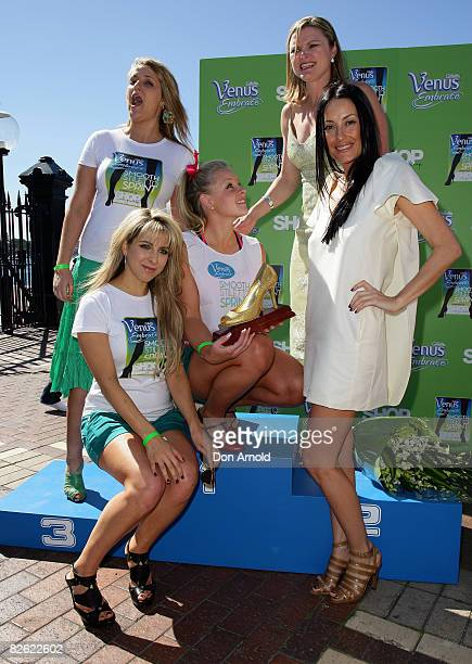 Brittaney McGlone , flanked by Bianca Dye, Melinda Gainsford-Taylor, Terry Biviano and Samantha Brett, poses for a photo after winning a 80 metre...