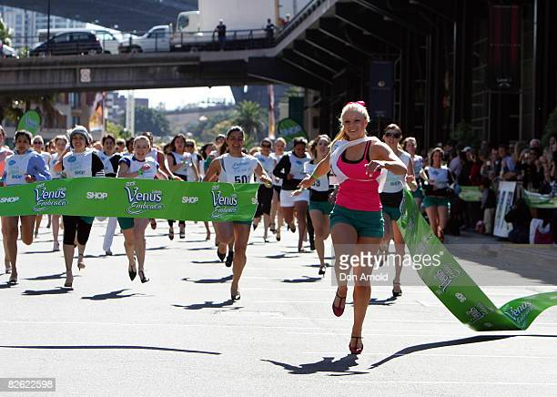 Brittaney McGlone wins a 80 metre world record attempt stiletto race at the Overseas Passenger Terminal on September 2, 2008 in Sydney, Australia.