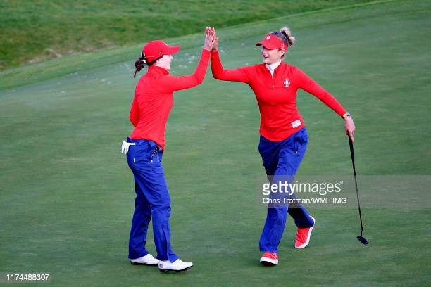 Brittany Altomare and Nelly Korda of Team USA celebrate after they halved the match on the eighteenth green during Day 1 of The Solheim Cup at...