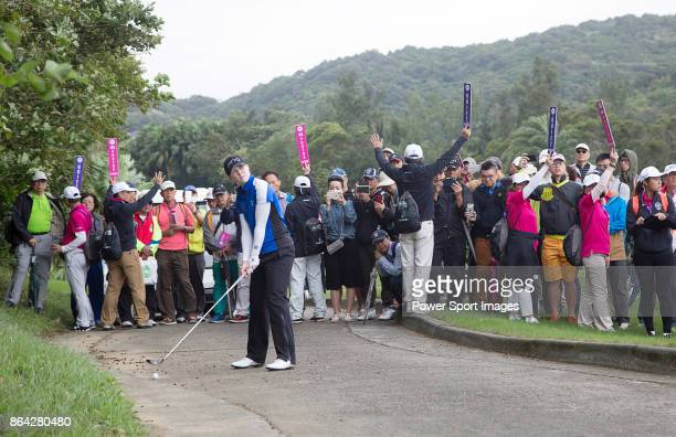 Brittany Altomare of the United States hits a shot from a cart path next to the 6th fairway during day three of the Swinging Skirts LPGA Taiwan...