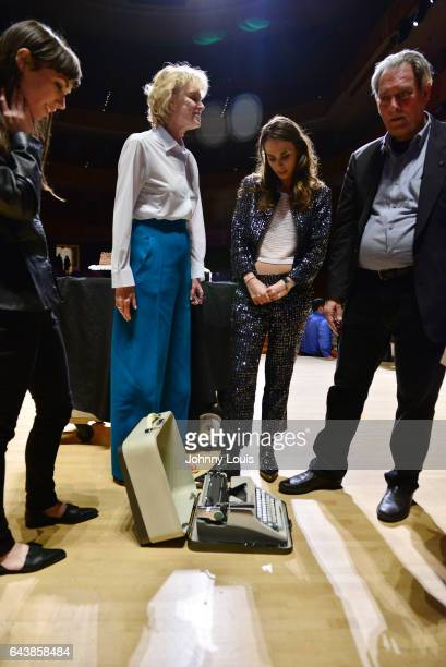 Brittany Anjou Siri Hustvedt Singer Sophie Auster and author Paul Auster onstage looking at his birthday gift after reading from his book during A...