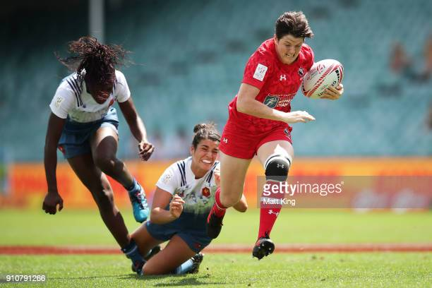 Brittany Benn of Canada beats the defence to score a try in the game against Fance during day two of the 2018 Sydney Sevens at Allianz Stadium on...