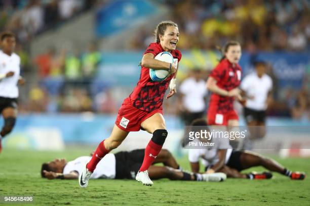 Brittany Benn of Canada heads for a try in the game between Canada and Fiji during Rugby Sevens on day nine of the Gold Coast 2018 Commonwealth Games...