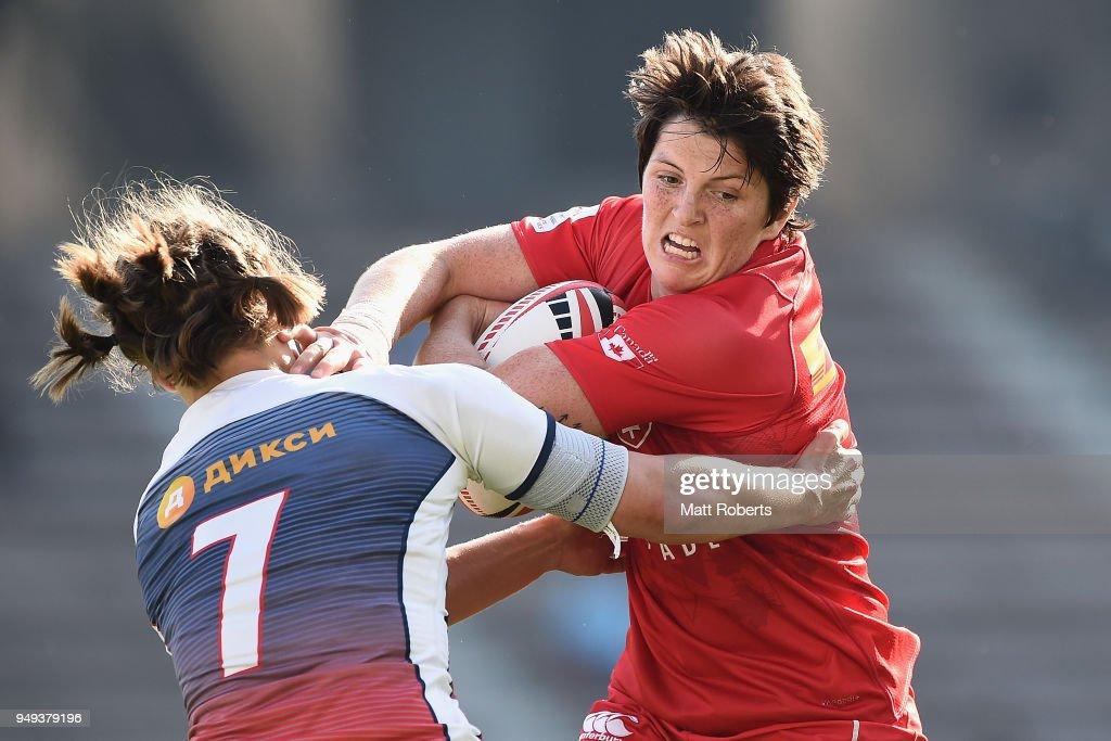 Brittany Benn of Canada is tackled by Kristina Seredina of Russia on day one of the HSBC Women's Rugby Sevens Kitakyushu Pool match between Canada and Russia at Mikuni World Stadium Kitakyushu on April 21, 2018 in Kitakyushu, Fukuoka, Japan.