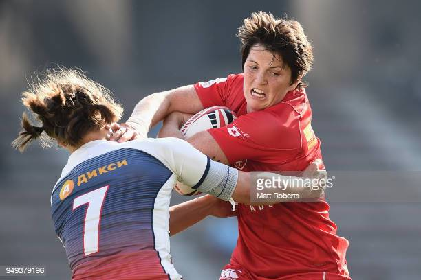 Brittany Benn of Canada is tackled by Kristina Seredina of Russia on day one of the HSBC Women's Rugby Sevens Kitakyushu Pool match between Canada...