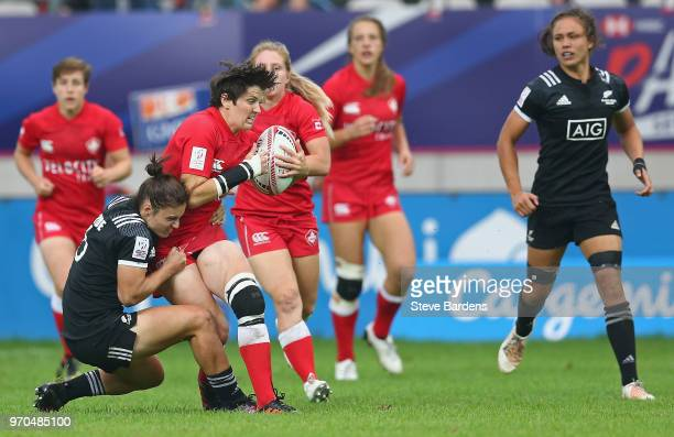 Brittany Benn of Canada is tackled byMichaela Blyde of New Zealand during the Women's Cup semi final between New Zealand and Canada during the HSBC...