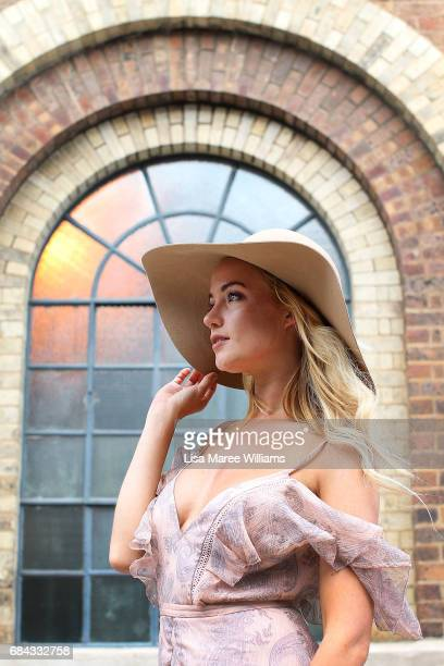Brittany Bloomer wearing a TJD dress from Glam Corner and hat by Miss Shop during MercedesBenz Fashion Week Resort 18 Collections at Carriageworks on...