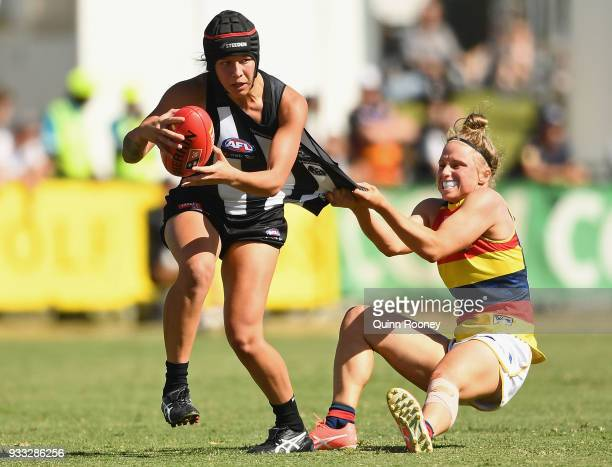 Brittany Bonnici of the Magpies is tackled during the round seven AFLW match between the Collingwood Magpies and the Adelaide Crows at Olympic Park...