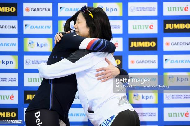 Brittany Bowe of the United States and Miho Takagi of Japan stand on the podium after the women's 1500m duing the ISU World Cup Final at the Utah...