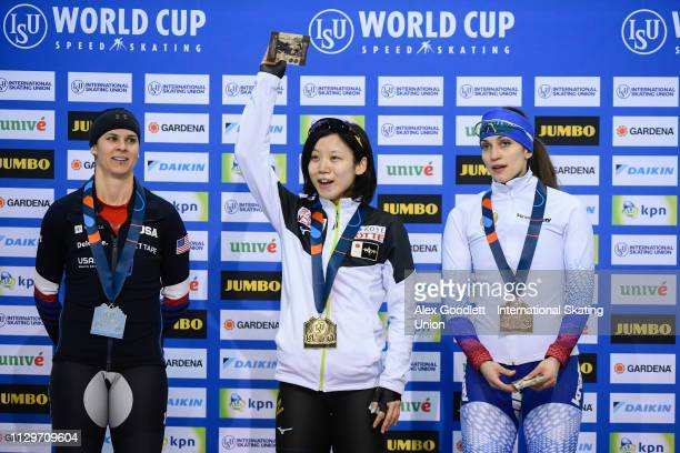 Brittany Bowe of the United States Miho Takagi of Japan and Yekaterina Shikhova of Russia stand on the podium after the women's 1500m duing the ISU...