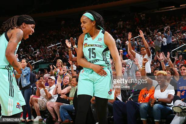 Brittany Boyd of the New York Liberty celebrates with Shavonte Zellous of the New York Liberty during the game against the Connecticut Sun on July 17...