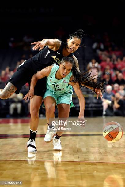 Brittany Boyd of the New York Liberty goes for the rebound against Tamera Young of the Las Vegas Aces on August 15 2018 at the Allstate Arena in...