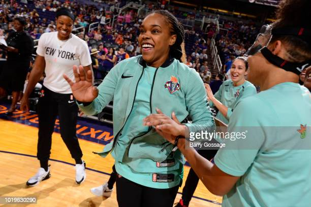 Brittany Boyd of the New York Liberty high-fives teammates before the game against the Phoenix Mercury on August 19, 2018 at Talking Stick Resort...