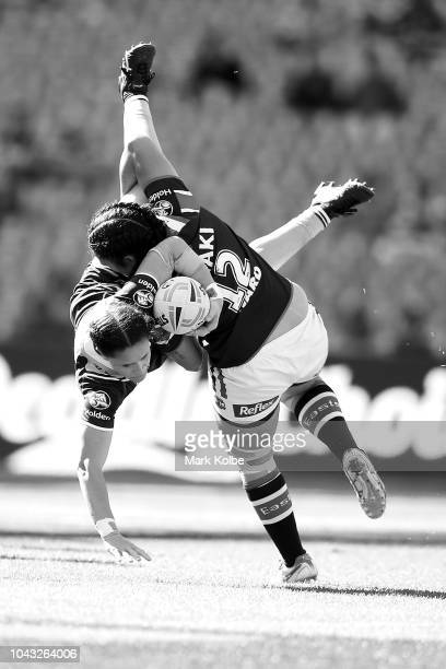 Brittany Breayley of the Broncos is tackled by Vanessa Foliaki of the Roosters during the 2018 NRL Women's Premiership Grand Final match between the...
