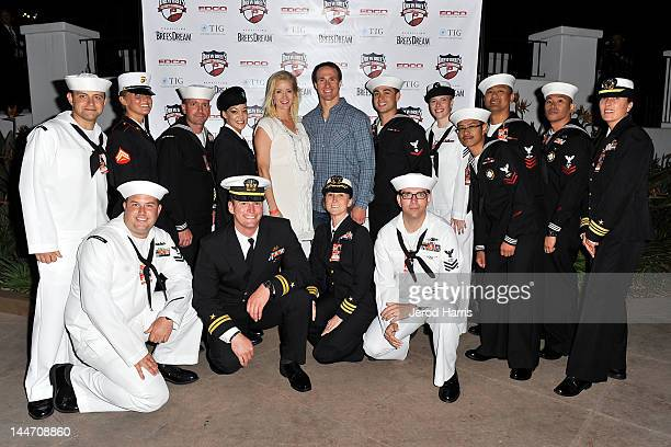 Brittany Brees and Drew Brees pose with members of the military at the start of the Drew Brees Celebrity Championship with GREY GOOSE¨ Vodka on May...