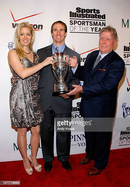 Brittany Brees Sportsman of the Year Drew Brees of the New Orleans Saints and Sports Illustrated Managing Editor Terry McDonnell pose with the trophy...