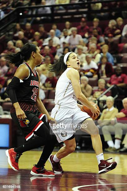Brittany Brown guard Florida State University Seminoles starts a layup attempt against Asia Durr guard Louisville Cardinals in an Atlantic Coast...
