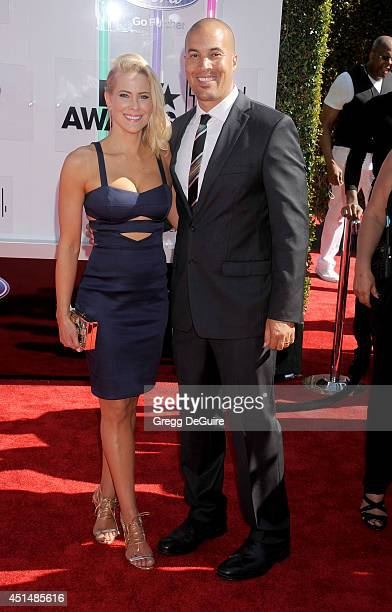 Brittany Daniel and Coby Bell arrive at the BET AWARDS 14 at Nokia Theatre LA Live on June 29 2014 in Los Angeles California