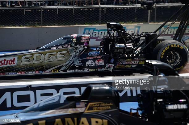 Brittany Force shoots down the track during round two of the Top Fuel competition at the MOPAR Mile High Nationals July 20, 2014 at Bandimere...