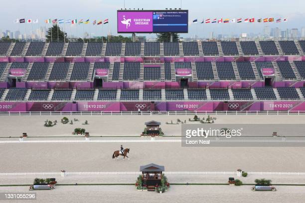 Brittany Fraser-Beaulieu of Team Canada riding All In competes in the Dressage Individual Grand Prix Freestyle Final in front of empty stands on day...