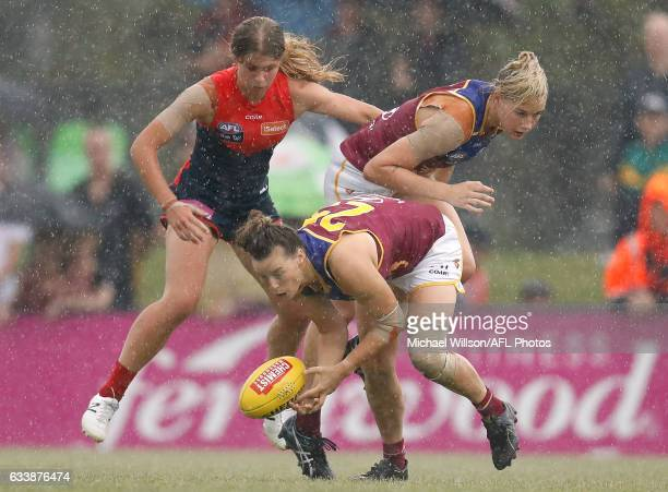 Brittany Gibson of the Lions gathers the ball during the 2017 AFLW Round 01 match between the Melbourne Demons and the Brisbane Lions at Casey Fields...
