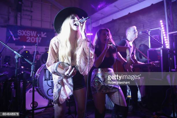 Brittany Hölljes Elizabeth Hopkins and Ian Hölljes of Delta Rae perform on stage at The Big Machine Label Group Showcase at TuneIn Studios @ SXSW...